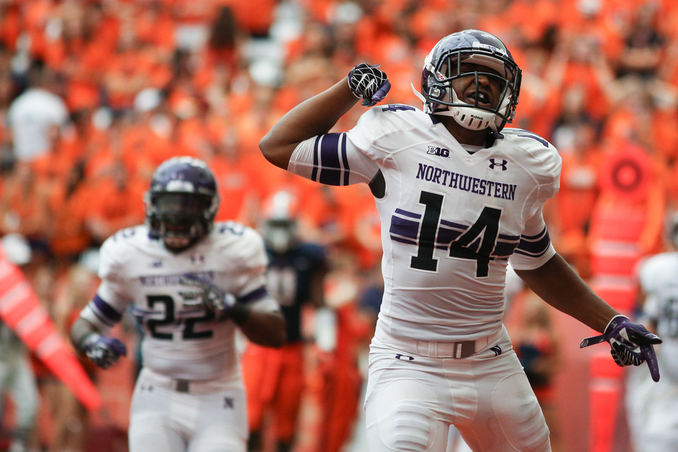 Christian Jones celebrates after scoring a touchdown in the first half of the 2012 opener at Syracuse. Andrew Renneisen / The Daily Orange