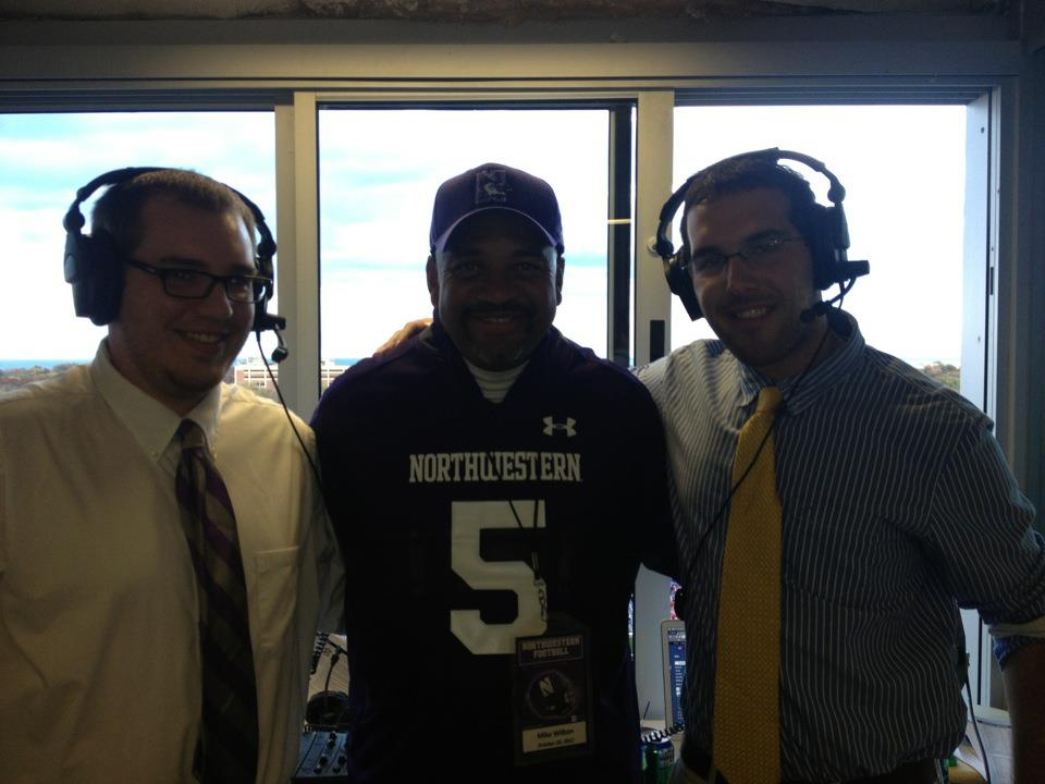 WNUR broadcasters meet with ESPN Mike Wilbon during a broadcast.
