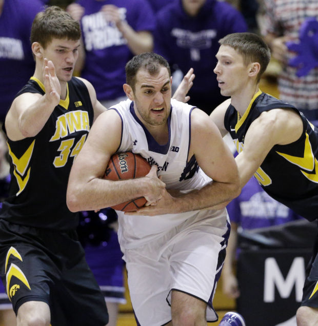 Alex Olah took over down low in the middle of the 2-3 zone late in the season, helping the Wildcats to a first-round bye in the Big Ten Tournament and earning him our staff's Northwestern player of the year award. Photo credit: Quad-City Times.
