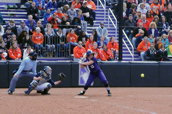 Northwestern's Olivia Duehr, shown here against Illinois, hit four homers this weekend in a softball sweep at Penn State to open Big Ten play, and added another today in NU's historic win over Wisonsin. Photo credit, Josh Walfish, Daily Northwestern.