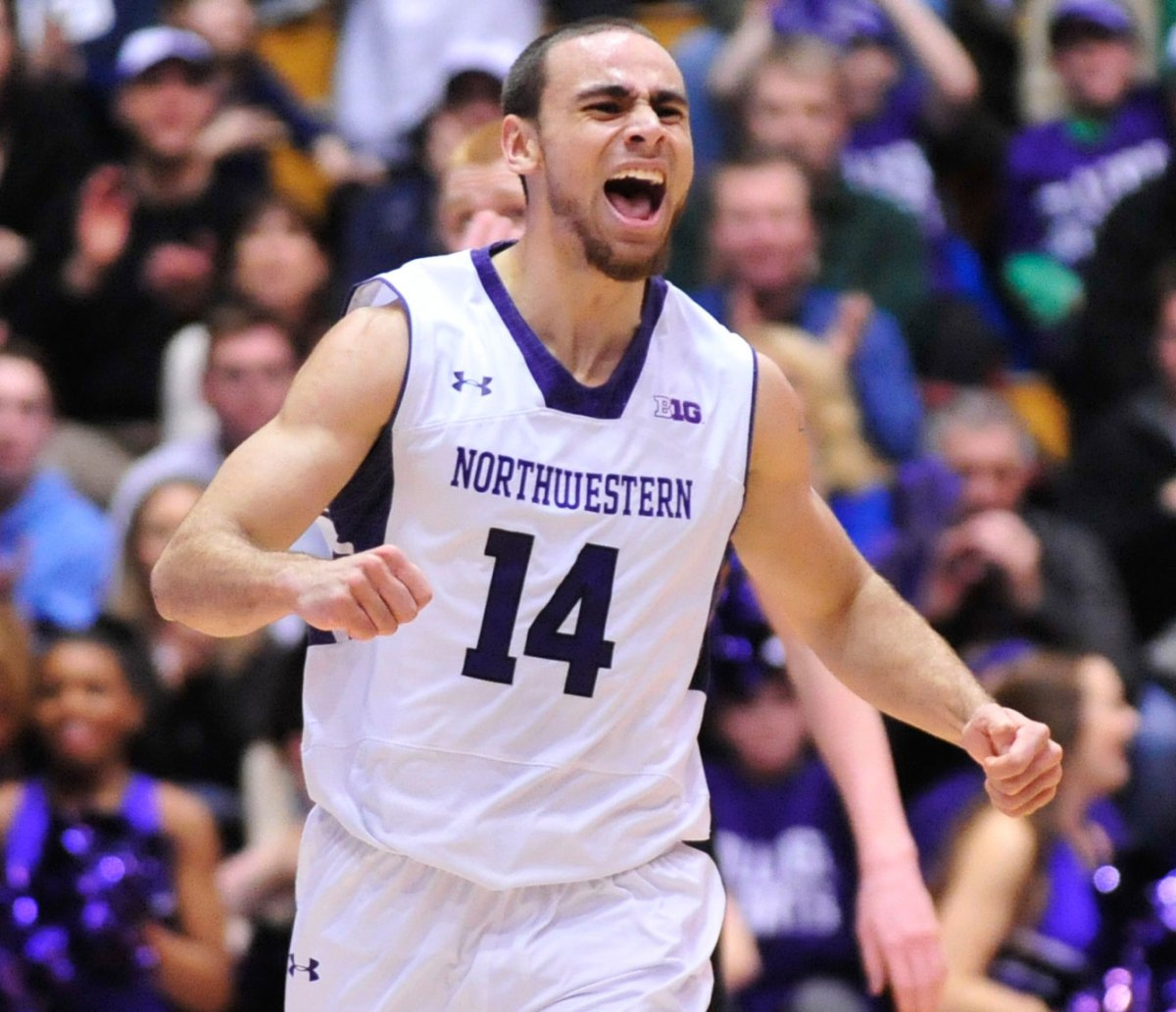 Tre Demps was all smiles after he hit three clutch triples to force overtime and double overtime in a stunning Northwestern victory over Michigan. Do Ari and Ryan have an award for him? Photo credit: David Banks, USA Today Sports.