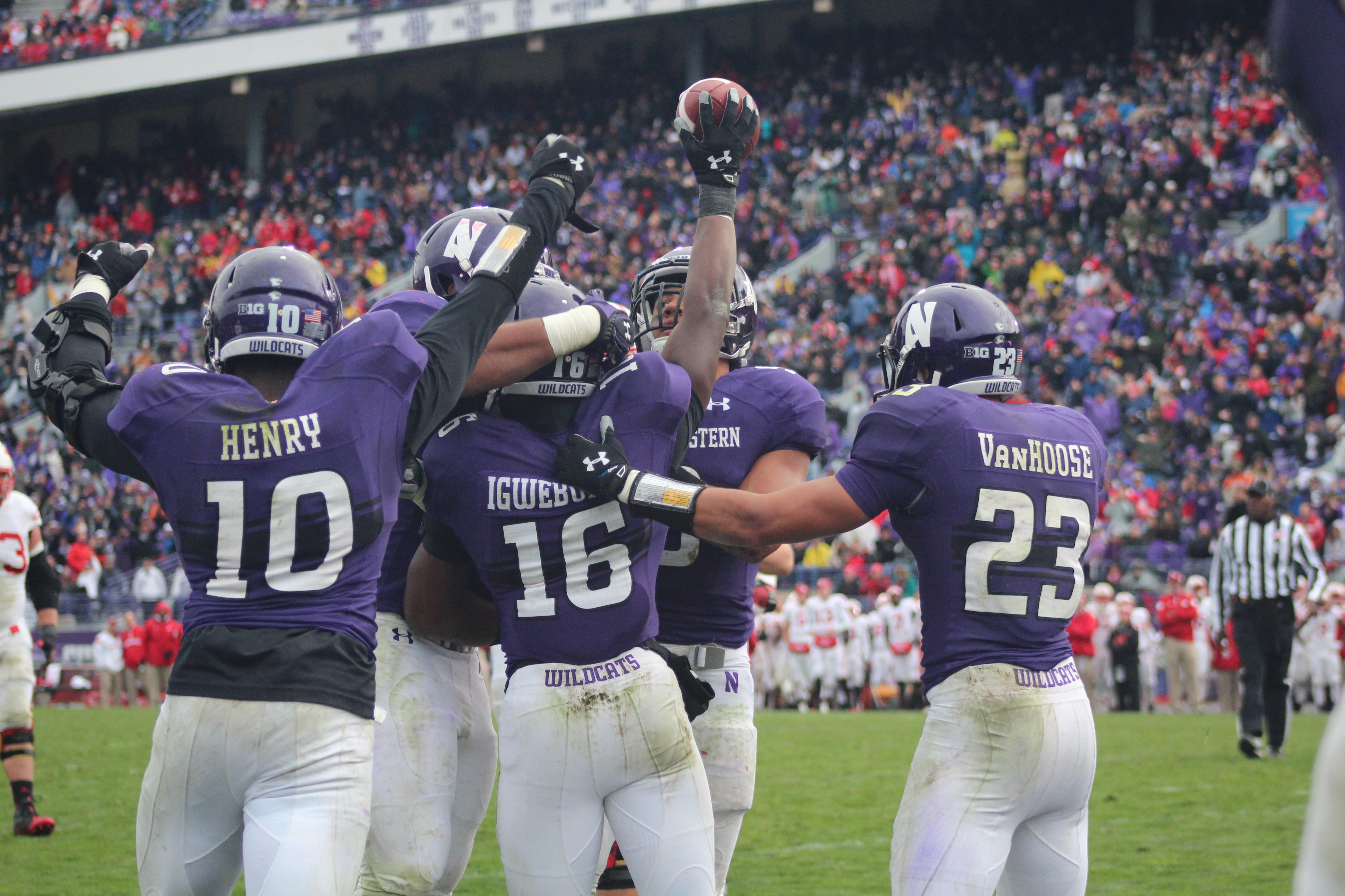 The Wildcats celebrate a Godwin Igwebuike interception against Wisconsin. Photo Credit: Mia Zanzucchi / North by Northwestern
